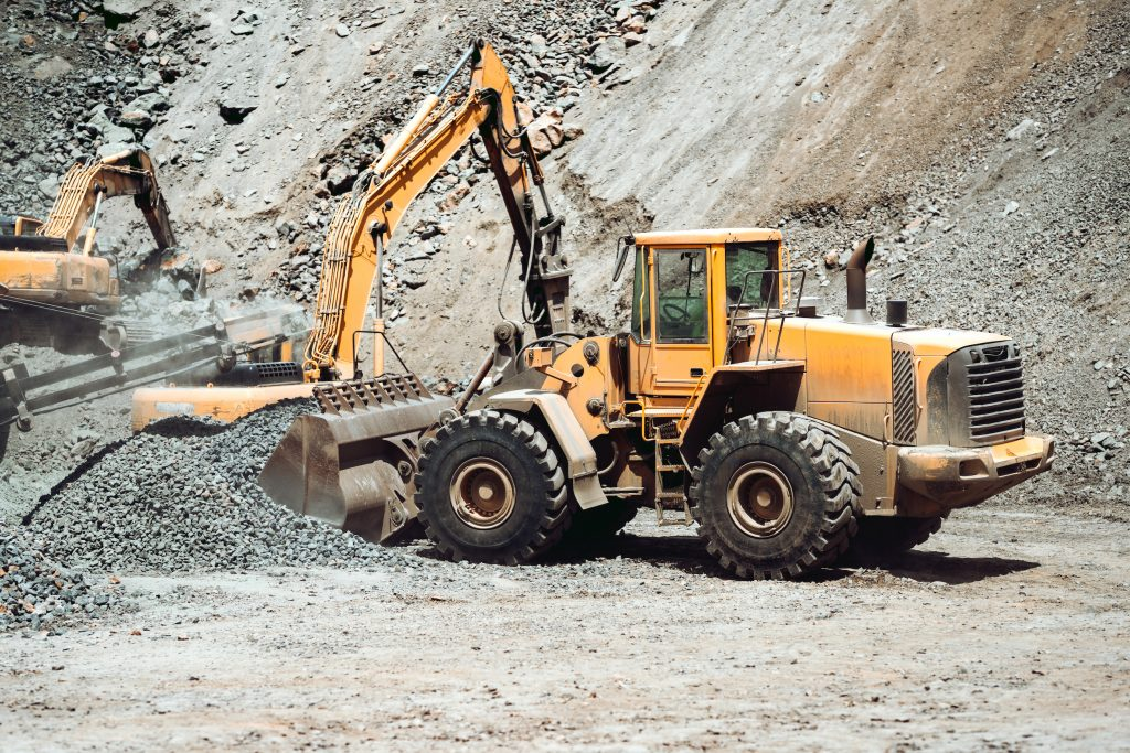 heavy construction machinery in mine - wheel loader transports gravel in a gravel sorting plant
