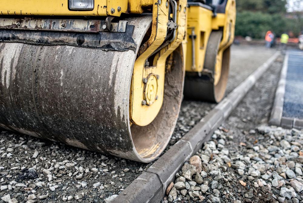 heavy-tandem-road-roller-compacting-layers-of-grav-PTBS9JM