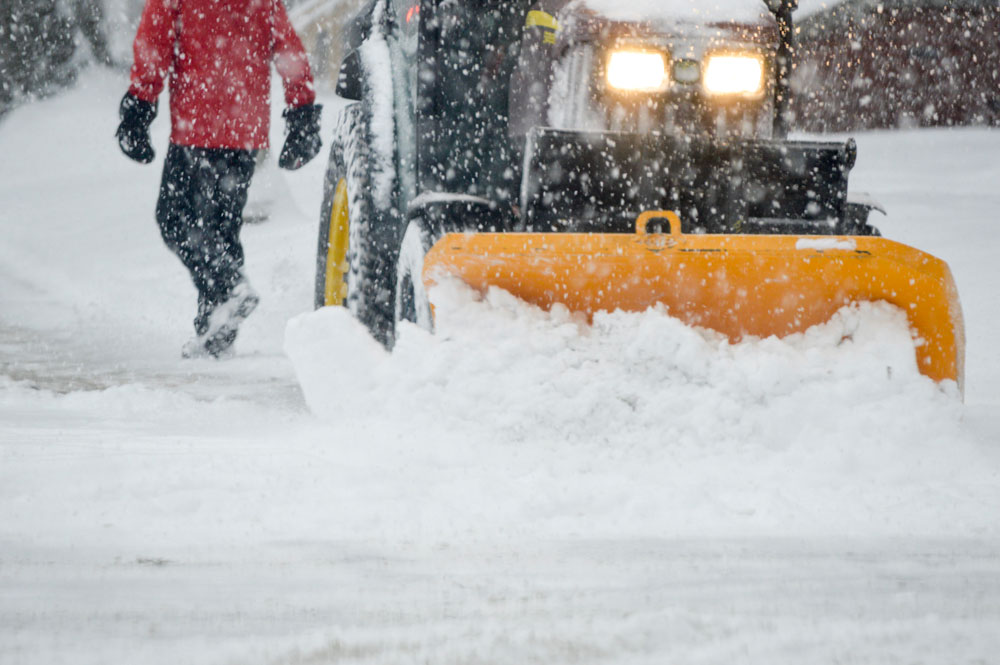 person-walking-during-heavy-snowfall-with-tractor--EMQETAL